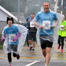Runners were all smiles as they braved the wind and the rain at the Farranfore Main Valley Athletic Club's annual 5km run on Stephen's Day morning