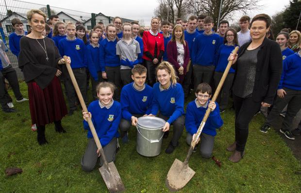 Castleisland Community College Principal Carmel Kelly (left) and teacher, Anette Steinborn with leaving cert students, David Knurowski and Labhaoise Walmsley, Castleisland, flanked by first year students, Sarah O'Connor and Ruairí Mannix, both from Ballymacelligott, as they prepared to bury the college's 30th anniversary time capsule on Winter Solstice Day. Photo by John Reidy
