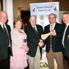 East Kerry Board Hurling Officer Gary O'Halloran presents a special award to Pat Delaney in honour of his service to the board and to hurling life in Kerry with (left) Johnny Brosnan Vice Chairman EKB, Bridget Delaney and EKB Chairman Tim Ryan at the East Kerry GAA Board All Stars Dinner in the Gleneagle Hotel, Killarney on Friday. Photo by Michelle Cooper Galvin