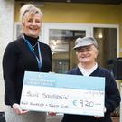 Treasa Ni Chroinin (left) Principal of Scoil Saidhbhin receives a cheque from Kathleen O'Sullivan of €920 from the sales of her Christmas Community Calendar.