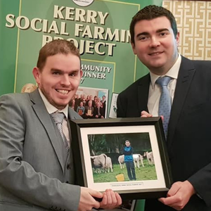 Minister of State at the Department of Transport, Tourism and Sport Brendan Griffin presents Tim Heffernan with a framed photo of his work on The Kerry Social Farming Project