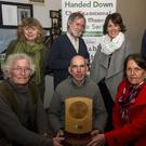 At the presentation of the Dan O'Connell Memorial Award to the Handed Down team at Scartaglin Heritage Centre on Saturday night were: Timmy 'The Brit' McCarthy (left) and Mairéad Kiely presenting the award to handed Down co-founder, PJ Teahan. Back row: Rhona McCarthy, Jackie Daly, Aileen Cronin and Mick Culloty, Handed Down co-founder. Photo by John Reidy