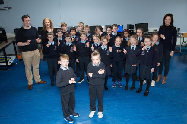 Stephen White of Ardfert NS pictured with his third class pupils who have all worked extremely hard over the last few months to perfect their sign language skills
