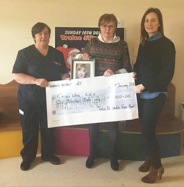 Deirdre Moore and Mags Quillinan presenting the cheque for €6,000 to the Cashel Ward at University Hospital Kerry.