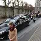 The funeral cortege of Ted Moynihan leaving St John's Church on Saturday morning