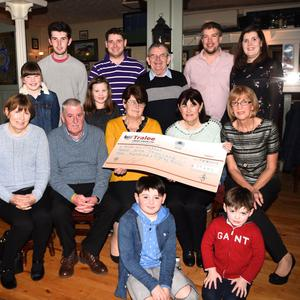 Rhys and Harry Murphy (seated from left) Kathleen Boyle, David, Bridget and Teresa Murphy, Kathryn Breen (back from left) Rhianna Murphy, Daragh Fitzgerald, Caoimhe Russell, Kieran and Patsy Murphy, Billy and Juliet Russell with the €29,480 cheque for the Siobhan Mather Fund at Bunkers, Killorglin on Sunday. Photo by Michelle Cooper Galvin
