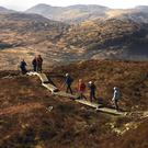 Walkers on Torc Mountain in Killarney National Park, which will benefit under the new National Development Plan. Photo: Don MacMonagle