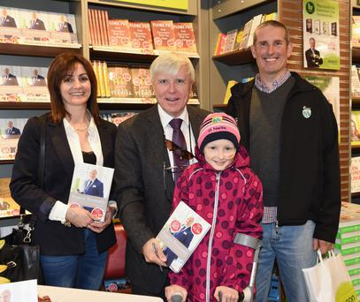 The last photo of Amy published in The Kerryman, taken on September 13, which shows Amy meeting Francis Brennan as he signed his new book, with Amy's parents Triona and Brendan O'Connor, at Eason's Bookshop, Main Street, Killarney. Photo by Michelle Cooper Galvin