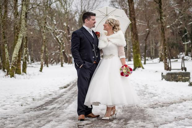 Juliette Fleming and Ger O'Donoghue on the occasion of their winter wonderland wedding. Photo by John Reidy