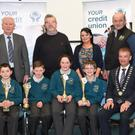 John Long Chairman Chapter 23 Credit Union (seated right) who presented 2nd prize in the Chapter 23 Under 11 Schools Quiz to Liam O'Keeffe, Ross Moriarty, Greece Myers and Eoin Cashman of Holy Family National School, Rathmore with (back) Christy Killeen Secretary Chapter 23 CU, Jack Harrington, Clanmaurice CU, Principal Diarmuid McCarthy, Abina O'Sullivan, Rathmore CY, and at the Institute of Technology Tralee on Sunday. Photos by Michelle Cooper Galvin