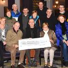 John O'Shea MS Walk Organiser (centre) presenting the cheque for €20,450.85 to Pat O'Neill Chairman South Kerry MS with (front) Kay Fleming, Rosemary Nolan, Jo Lawlor (back from left) Patrick O'Donoghue Man.Director Gleneagle Hotels sponsors, Norrie O'Neill, Tom McCarthy, Mike O'Gorman, Phil Neuby, John O'Sullivan, Jimmy O'Callaghan of O'Callaghan Coaches sponsors, Ray O'Callaghan and Mary O'Connor at the Gleneagles Hotel, Killarney on Monday. Photo by Michelle Cooper Galvin