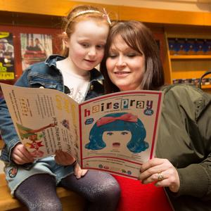 Aisling and Yvonne Donnelly looking over the 'Hairspray' musical programme at Siamsa Tire Tralee on Wednesday evening.