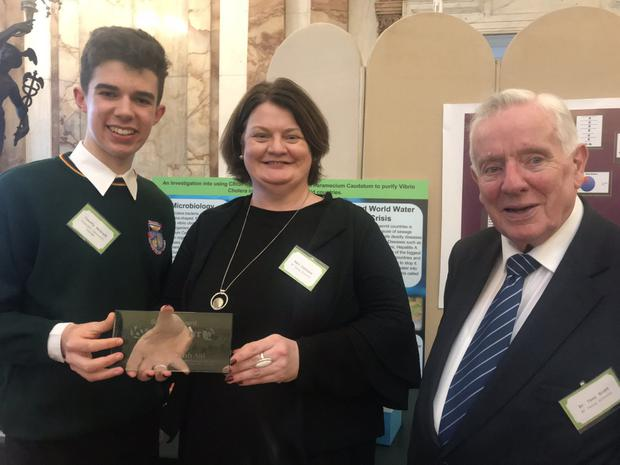 Timothy McGrath from Killorglin Community College with Mari Cahilane of BT and Dr Tony Scott, founder of the BT Young Scientist Exhibition, at a Science for Development event hosted by the Department of Foreign Affairs.