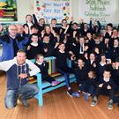KC Men's Shed members (Keel Castlemaine) Martin Greenwood, John Joe O'Brien and David Foley presenting their 'Buddy Bench' to the pupils of Fybough National School, with teacher Mary Dorgan, parents Rachel Hilliard, Principal Catherine Ní Mhuircheartaigh, teacher Eileen Lovett at Fybough National School on Tuesday. Photo by Michelle Cooper Galvin