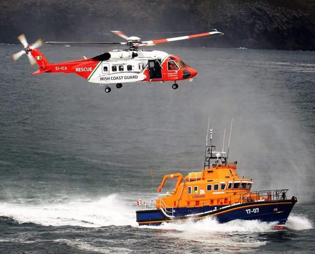 The Irish Coastguard helicopter and the Valentia Lifeboat performing a display near the Valentia Lighthouse