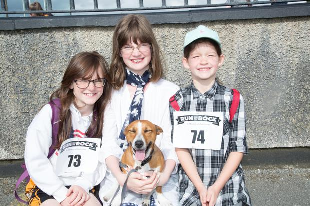Ready to take on the challenge of the Paul Lucey Memorial Run for the Rock on Monday were Jacinta, Jessica and Julie Griffin and Monty the Dog