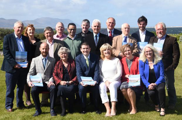 Minister Brendan Griffin with local organisations, council members and members of the local community in Cromane who helped with the new plan. Photo by Sinead Kelleher