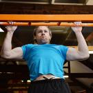 Eamonn Hickson from Luachar, Annascaul, on his way to setting a Guinness World Record for the must burpee pull-ups in one minute in the WK Fitness gym in Dingle on Saturday. Photo by Declan Malone