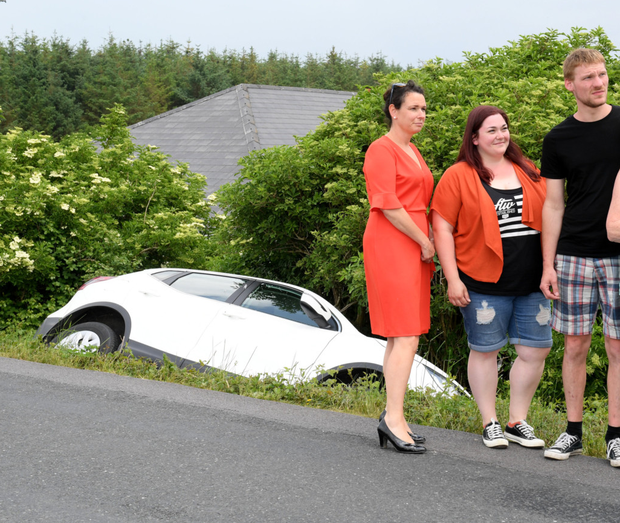 Cllr Aoife Thornton with German tourists Diandra Buesen and Daniel Joachim following their miraculous escape without injury from the latest crash on the treacherous Dale Road. Photo by Domnick Walsh