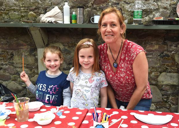 Nina Finn-Kelcey, Ellie Foley and Amelia McGillicuddy taking part in a little bit of painting at K-Fest Killorglin on Saturday. Photo by Michelle Cooper Galvin