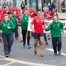 Garda Aidan O'Mahony led the torch run into Tralee on Monday evening with the help of his fellow gardaí and Special Olympians