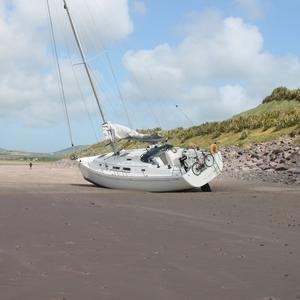 The yacht that was found off Waterville Golf Links on Thursday morning after a storm transported it from its mooring in Ballinskelligs. Photo by Sinead Kelleher