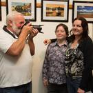 Cois Lí camera man Graham Davis getting in one last snap –of subjects Aileen Ward and Julie Deady – ahead of the opening of the club's exhibition at Kerry County Library on Tuesday