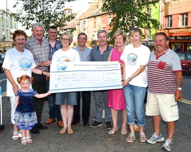 Brendan Ferris (second for left) Organiser of the Lawnmower Run presenting the proceeds of the recent Lawnmower Run in Killorglin €6002 to Maureen O'Brien, Siobhan McSweeney and Karen Foley of Recovery Haven with Amy McSweeney, Trisha Tyther, Anthony Doona, Frank Cronin, Brendan Tyther and Davy Fleming in Killorglin on Friday. Photo by Michelle Cooper Galvin