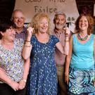 The champion potato growers of Paróiste na Cille Cois Cnoic and the wives who make it all possible. In first place was Finbarr McCarthy (centre) with his triumphant wife, Helen; Gearóid MacGearailt, with wife Helen (left), came second and Packie and Barbie Begley were third in Saturday night's Spud Off tasting in Begley's pub in Baile na nGall. Photo by Declan Malone