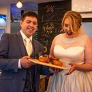Newlyweds Paul and Jenny Cotter pictured with the donuts.
