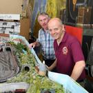 British Model Railway Club member Simon Starr, on the right, checking out the miniature rail displays with Kerry Model Railway Club members Leon Kelliher and Denis Murphy in Blennerville at the weekend. Photos by Domnick Walsh