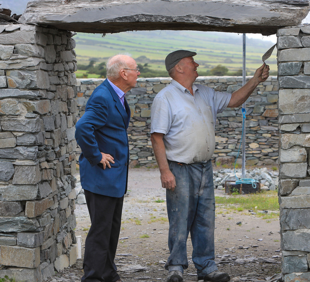 Stone mason Gerry Clifford with local historian and author Junior Murphy, as the front slab was placed at the entrance to 'Sive Ringfort' on the outskirts of Cahersiveen town