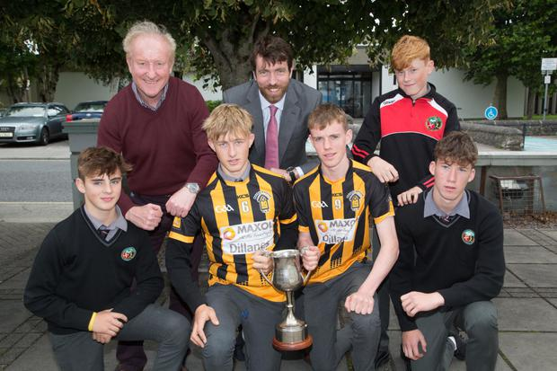 Students from Gaelcholaiste Chiarraí in Tralee who play on the Abbeydorney Minor Panel showing off the MinorHurling Champions Cup to the school on Friday. In the picture are Sean O'Murchú,Adam Ó Mainseal, Jed Mainseal, Tomás Ó hAiniféin, Breandán Breathnach, Eddie Ó Murchú agus Ruairí Ó Cinnéide (Principal)