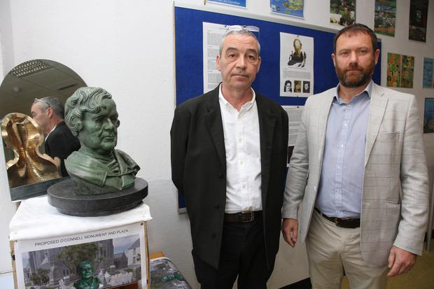 Artist Rory Breslin and ACARD director Michael O'Driscoll with a maquette of the planned O'Connell monument for Cahersiveen