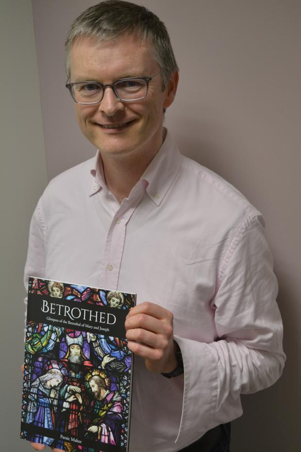 Listowel native Paraic Maher with his newly-published examination of the marriage of Mary and Joseph; and its many depictions in Irish stainedglass art