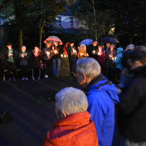 Members of the public observe a minute silence at the candlelight vigil in Pearse Park on Monday night to mark World Suicide Prevention Day. Photo by Fergus Dennehy
