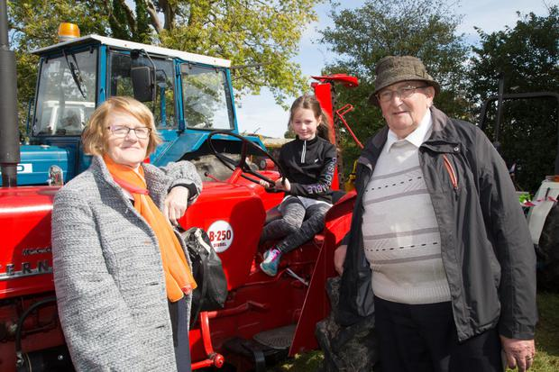 Sarah O'Connor pictured with her grandparents, Mary and John Burke, at the Ballymacelligott Vintage Rally at Ó Riada's grounds on Sunday afternoon