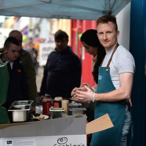 Jack O'Sullivan on duty at the Dingle GAA stand where beef burgers were being served at a hectic rate outside Paul Geaney's bar during the Dingle Food Festival. Photo by Declan Malone