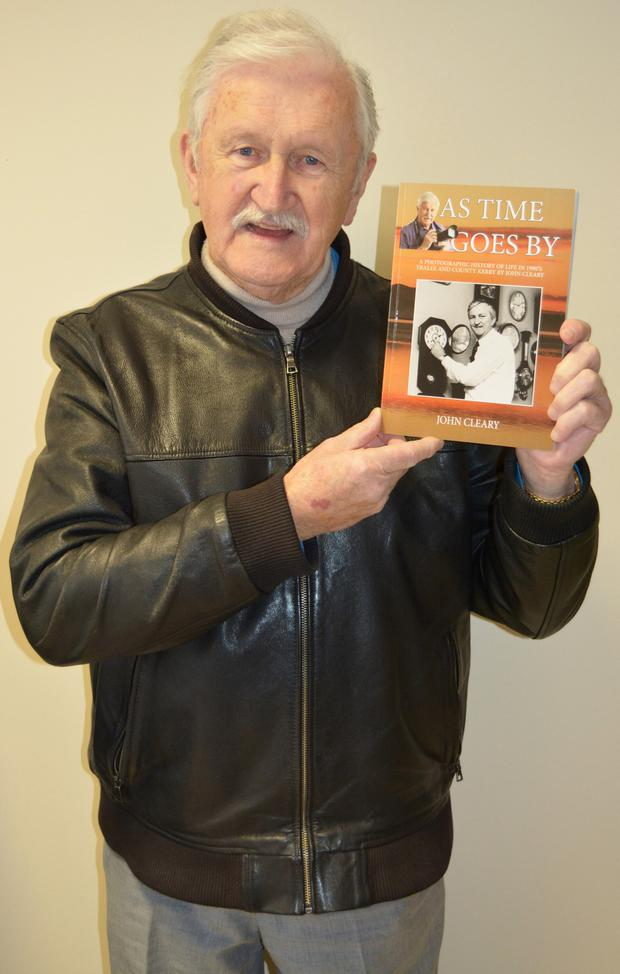 John Cleary holding a newly printed copy of his latest book 'As Time Goes By'. Photo by Fergus Dennehy.