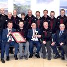 Justice Hugh O'Flaherty (seated centre from left) presenting the O'Flaherty International Humanitarian Ward to Colm Burke and Jimmy Laide of Kerry Mountain Rescue, with KMR members (back) John Cronin, Bertie Hickey, Liam Ryan, Richard Stack, Margaret Griffin, Eamon O'Connor, John O'Sullivan, Piaras Kelly, John Hussey, Don Murphy, Mick Long, with Paul O'Neill, Killarney Chamber; Killarney Mayor John Sheahan; Sen Paul Coghlan, Jerry O'Grady. Photo by Michelle Cooper Galvin