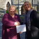 Kerry Convention Bureau Sales Manager Becky Hargrove presents a cheque to Marie Linehan the Chief Executive of the Kerry Parents and Friends Association