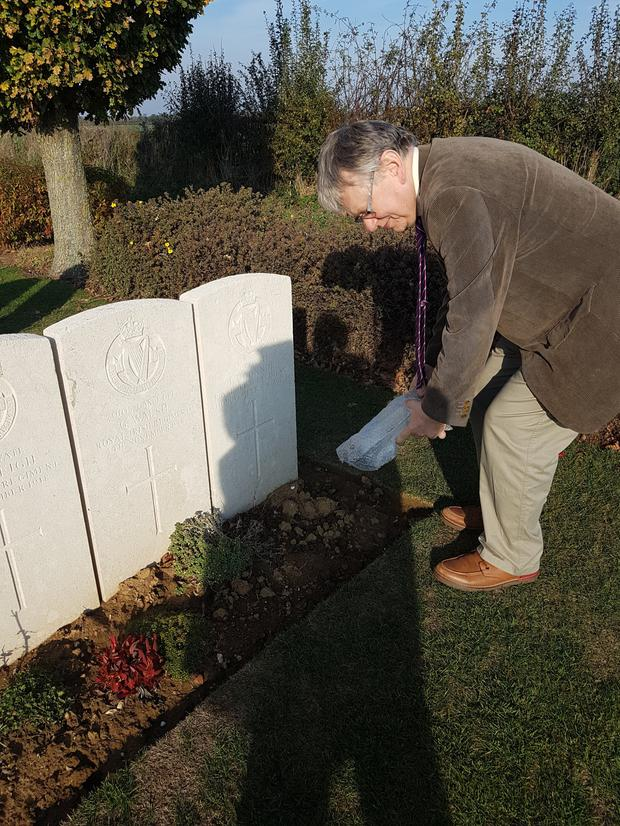 Gerry Waldron sprinkles some Tralee soil of the grave of 'Thady' O'Connor who was killed on November 4, 1918, one week before the signing of the Armistice and the end of the First World War