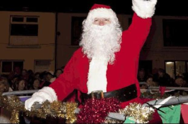 Santa Claus arrives in Abbeyfeale last year at the switching on of the Christmas lights. This years lights will be turned on this Saturday