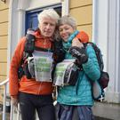 Runners Simon Clark and Rachel Winter pictured outside The Kerryman offices on Denny Street as they passed through Tralee on their 2,000-mile round run around the Irish coast. Photo by Fergus Dennehy