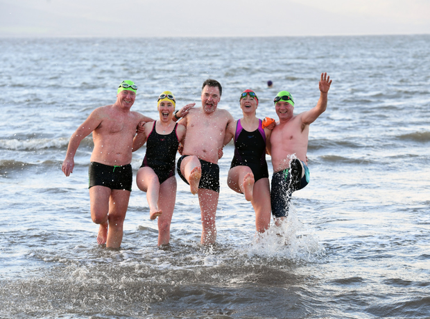 All smiles at Fenit on Sunday as swimmers took part in the charity 'Polar Plunge' event