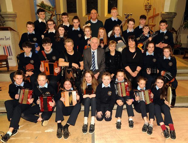 Front (from left) Fiona Nagle, Mairead Fitzpatrick, Delia Foley, Anna Cashman, Sean O'Keeffe ,Chloe Breen,Abbey Sheehan and Yasmin O Brien. Second row: Tommy Bowler, Mark O Leary, Liam O'Connor, Denis Kerins (Principal), Margaret Dennehy (Music teacher),Norma Aherne (TY co-ordinator) Cathy Kiely and Mairead Mahoney. Third row are Dinny Murphy, Melanie Redic, Niamh Mc Sherry, Megan Kiely, Amelia Swiczewska, Cliona Cotter, Ellen O'Connor, Cathal O'Connor, Christian Horgan and Ben Murphy. Back row: Sean Burke O'Donoghue, Daniel Burke O'Donoghue, Fr Pat O'Donnell, Michael Mc Sweeney and Cian O Leary at the 'Musical Spirit of Sliabh Luachra' concert featuring students from Scoil Phobail Sliabh Luachra with musician Liam O'Connor at St. Joseph's Church, Rathmore