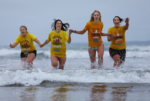 Ciara Collins, Noreen Galvin, Julette O'Sullivan and Treasa Murphy taking a second dip into the sea at Ballybunion at the fifth annual Connie Harnett New Year's Day Memorial Swim in Ballybunion in aid of local charities. Photo: Valerie O'Sullivan