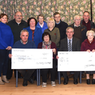 Brendan Dennehy presenting the cheque for €1,000 to Marie O'Sullivan, Castlemaine Community Centre; Denis Tangney presenting the cheque for €2,000 to Sr Helen of St Joseph's Home Killorglin; with Maureen O'Brien, Recovery Haven, and Mary Fitzgerald, Oncology Unit UHK, receiving €3,000 each from Michael McKenna, proceeds of the Mid Kerry Vintage Rally in Castlemaine. Second row from left: Helen Cronin, Eileen Flynn, Marie Crowe, John Griffin, Sr Elizabeth, Maureen Barnes, Stephen Bell, Michael O'Shea. Back: Maurice Daly, Noreen Baxter, Colman O'Sullivan, Michael O'Sullivan, Jerry Clifford and David Lovett. Photo by Michelle Cooper Galvin