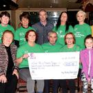 Christy Lehane and volunteers from the 'Kerry Friends of Motor Neurone' pictured receiving a cheque of €7,211 – the proceeds of a recent coffee morning fundraiser and charity abseil challenge. Photo by Michelle Cooper Galvin