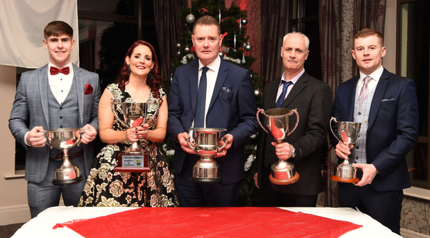 Under-20 Footballer of the Year Donal O'Sullivan; Club Secretary JoAnn Murphy; County Board Chairman Tim Murphy, Club Chairman John Foley and team captain Patrick O'Shea celebrating Kilgarvan's victories at the Kilgarvan victory social in the Kenmare Bay Hotel, Kenmare, on Friday. Photo by Michelle Cooper Galvin